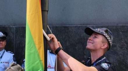 Queensland police lgbti liaison mairead devlin rainbow flag