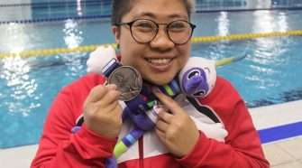 Swimmer Theresa Goh, who was born with spina bifida and gets around in a wheelchair