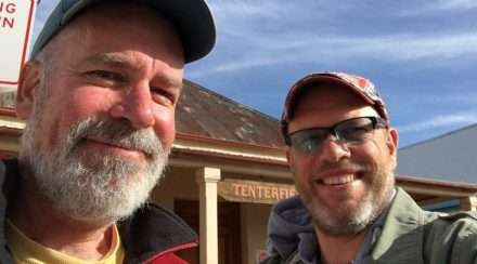 Richard Moon and Michael Burge pose outside the Tenterfield Saddler in Tenterfield, New South Wales ahead of the Peter Allen festival