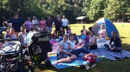 Rainbow Families Queensland members gather together at an event in a park