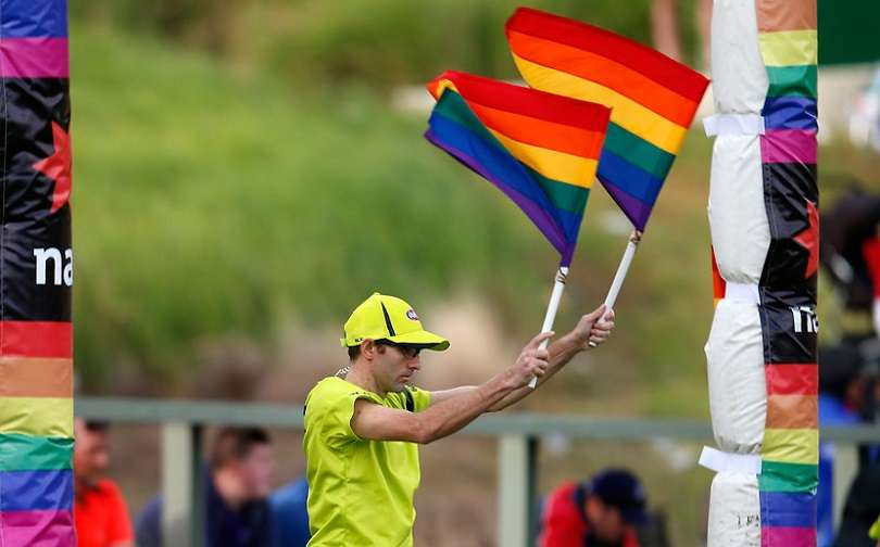 AFL umpire rainbow flags