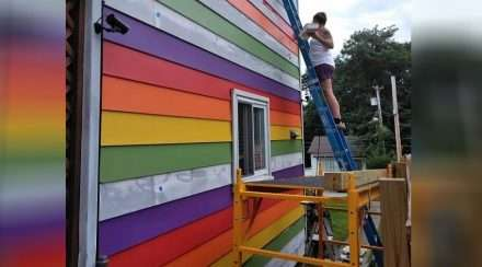 Lesbians paint house rainbow