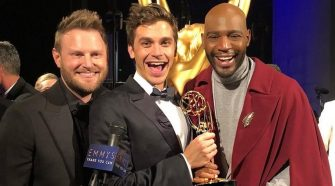 Queer eye Holding Emmy