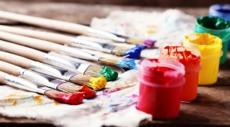 rainbow paint brushes stock photo