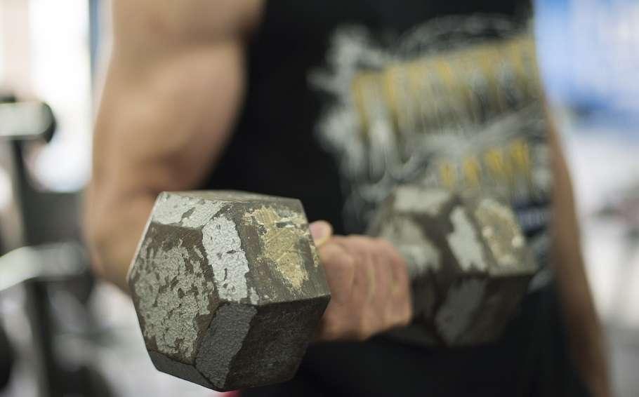 Stock photo man lifting weight