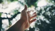 fingers hand reaching up uplifting stock photo