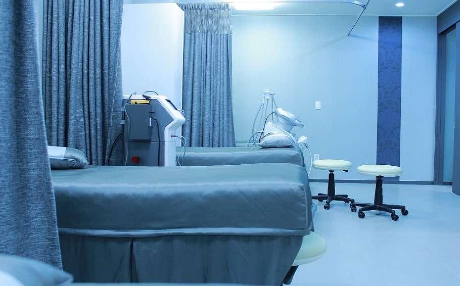transgender healthcare discrimination hospital ward bed stock photo