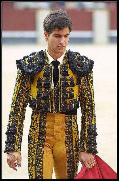 a matador in yellow