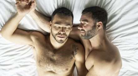 gay men gay couple naked in bed stock photo coronavirus