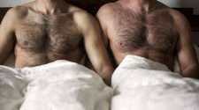 two hairy men in bed stock photo covid-19 coronavirus gay prep hiv prevention