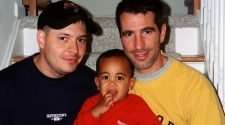 gay couple adopt baby subway train station