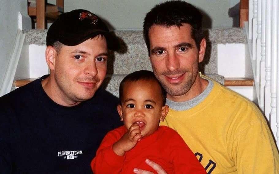gay couple adopt baby subway train station