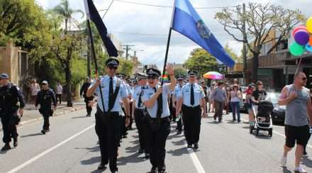 brisbane pride march police marching in uniform